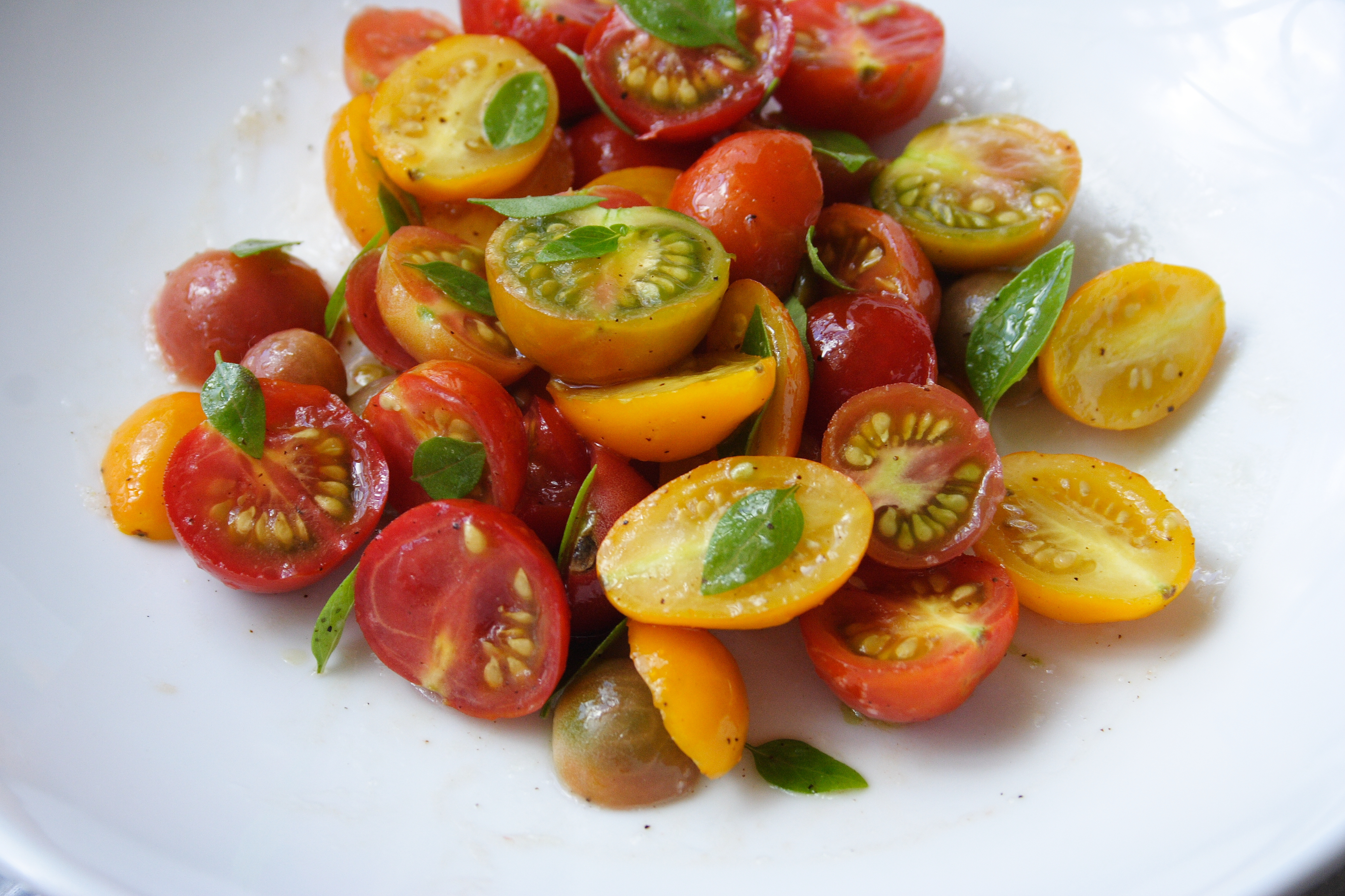 Plated cherry tomato salad.